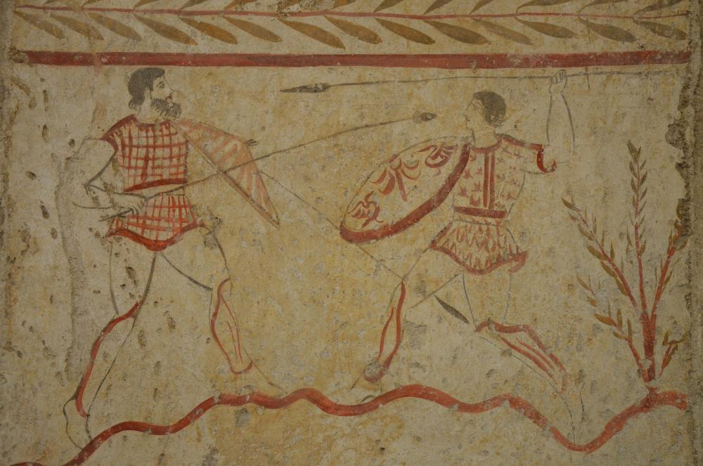 Lucanian_fresco_tomb_painting_of_a_two_men_fighting,_3rd_century_BC,_Paestum_Archaeological_Museum_(14416565189).jpg