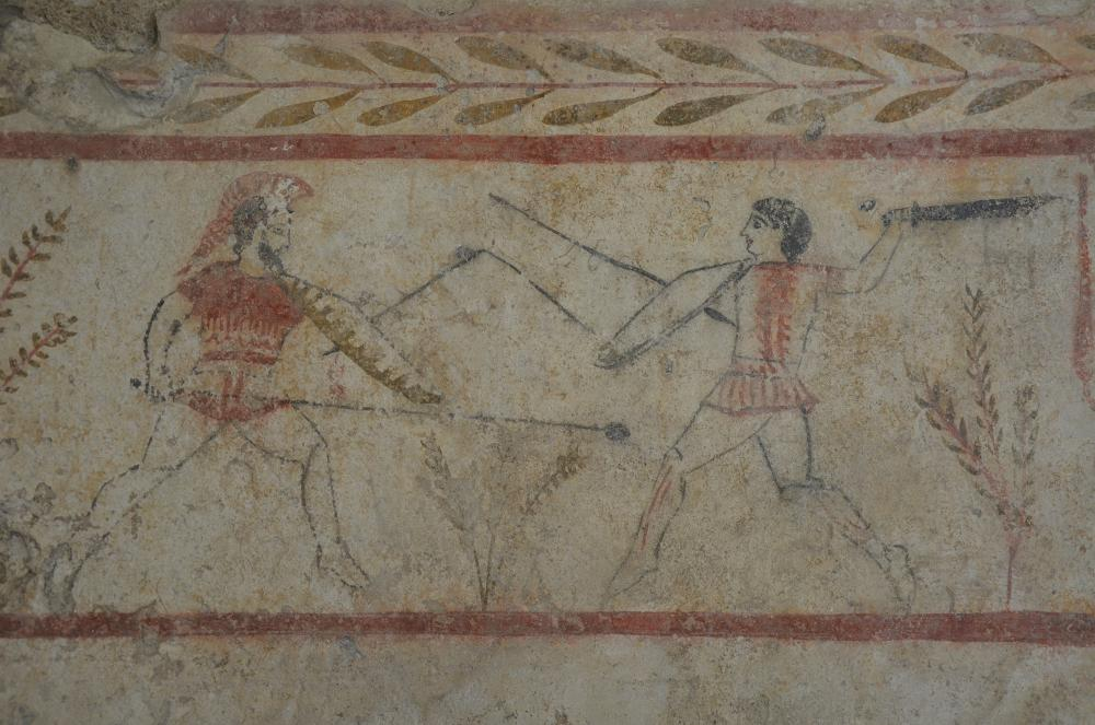 Lucanian_fresco_tomb_painting_depicting_a_duel,_375-350_BC,_Paestum_Archaeological_Museum_(14599884491).jpg