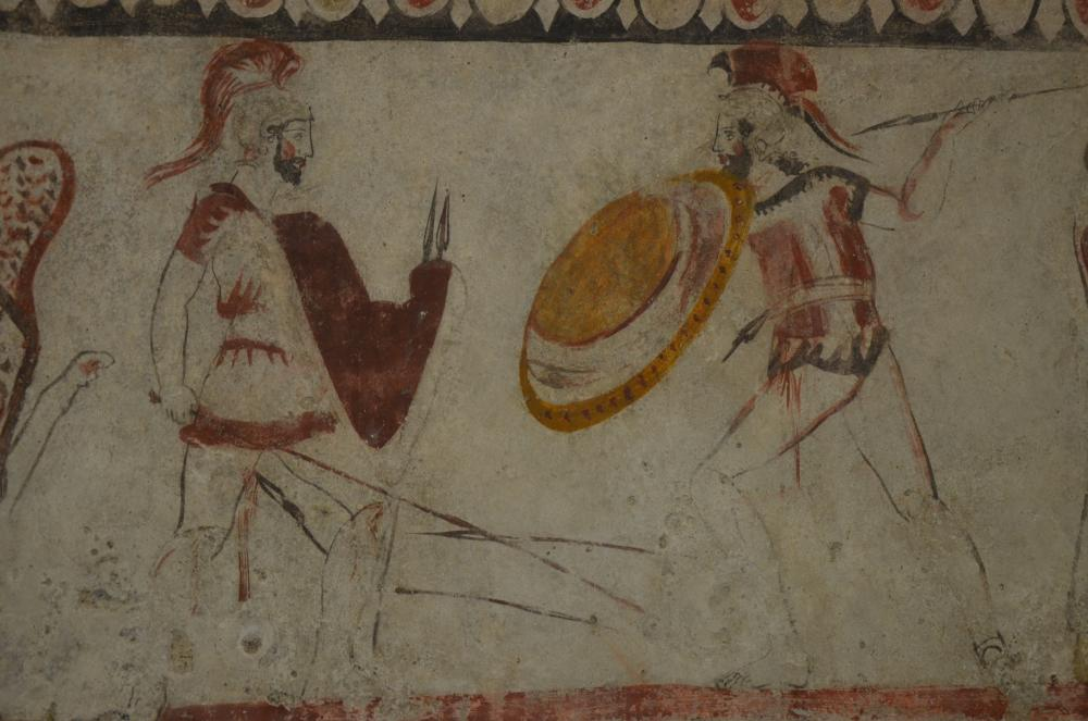 Lucanian_fresco_tomb_painting_depicting_a_duel_judge_by_a_sphinx,_340_BC,_Paestum_Archaeological_Museum_(14416492100).jpg