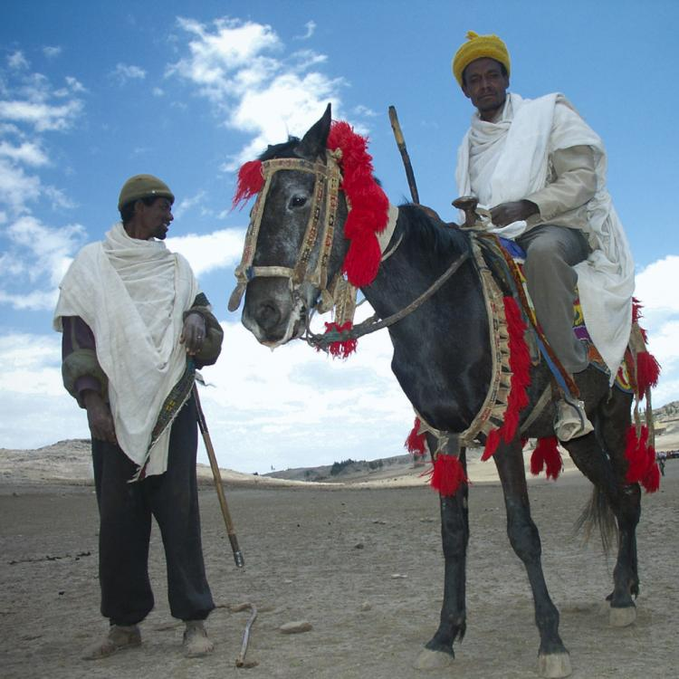 Man back from funerals on his horse, Highlands, Ethiopia