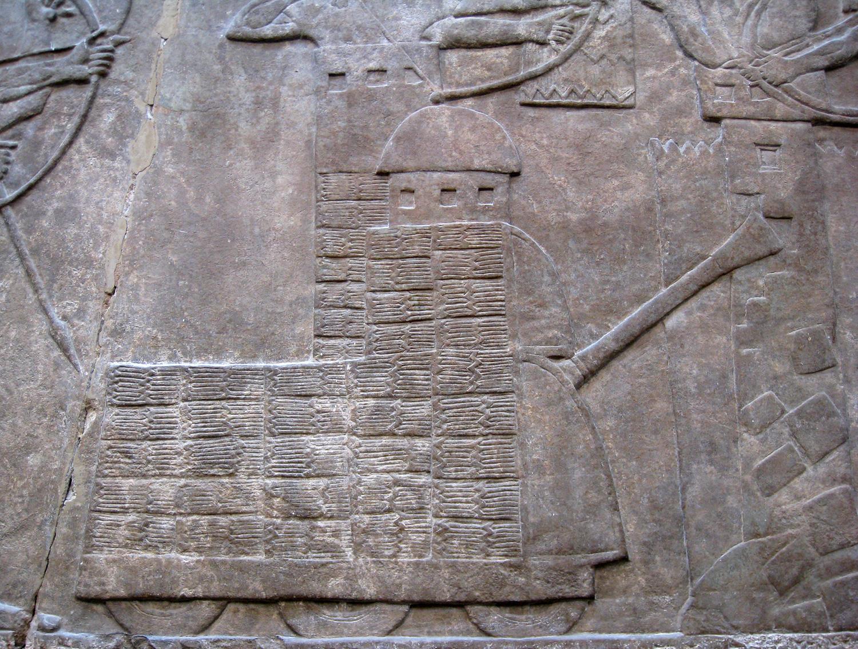 https://upload.wikimedia.org/wikipedia/commons/8/88/Assyrian_battering_ram.jpg