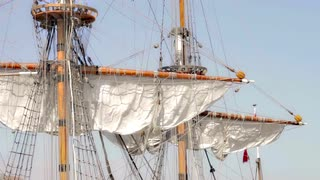 an-antique-pirate-sail-ship-with-sails-folded-on-mainmast_egxwh1etvl__S0000.jpg