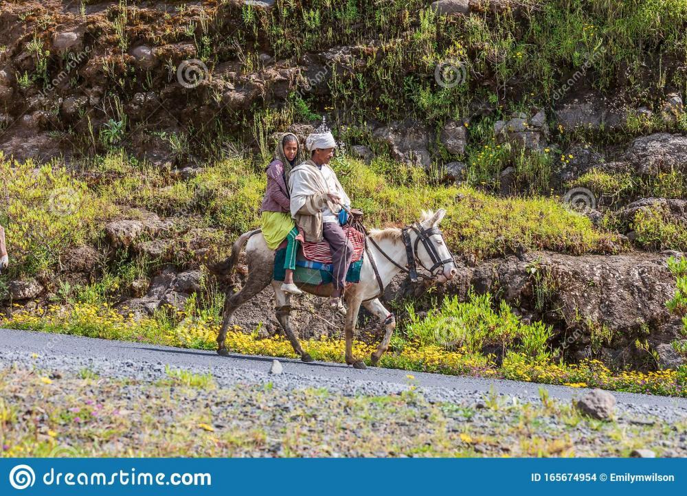 man-girl-riding-horse-road-ethiopian-hig