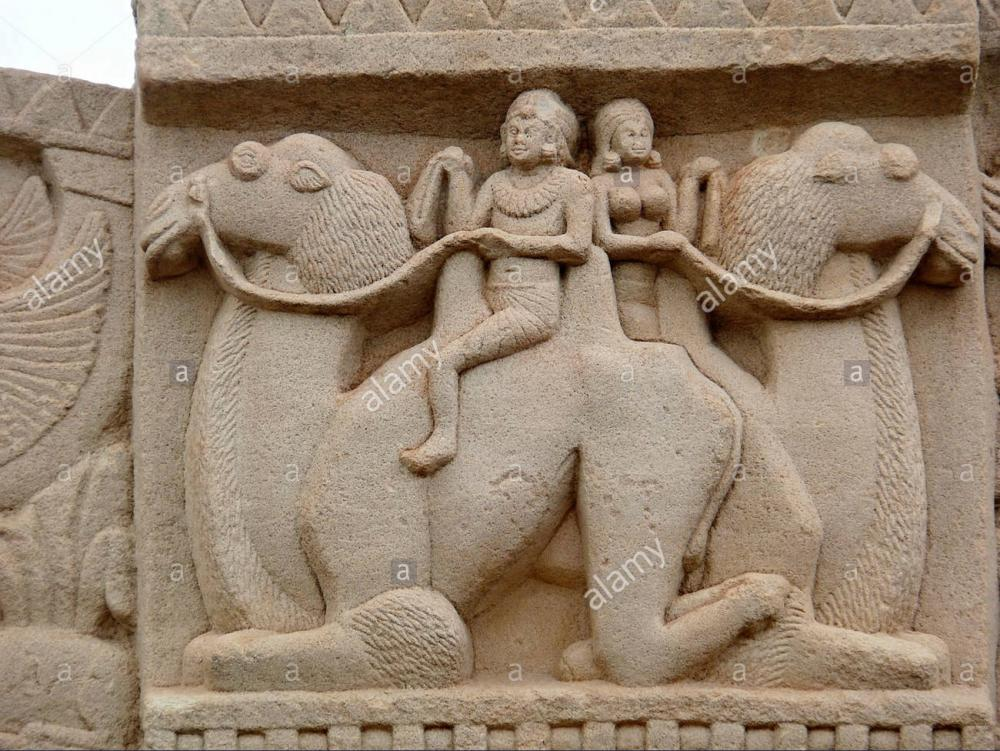 man-and-a-woman-are-seating-and-riding-on-camels-sanchi-stupa-no-1-DFYF22.thumb.jpg.a2cc081e5c78d01e9cb4ad3c533757a6.jpg