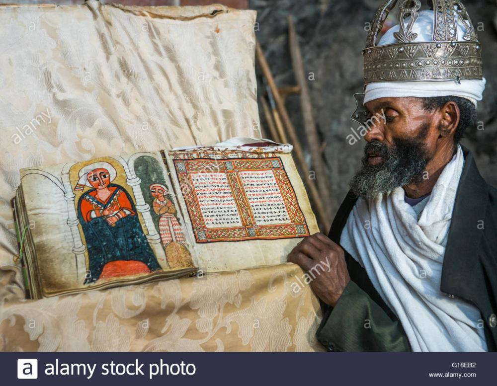 ethiopian-orthodox-priest-with-an-old-bible-in-nakuto-lab-rock-church-G18EB2.thumb.jpg.8ca00135ccec191deb935250fc45f22f.jpg