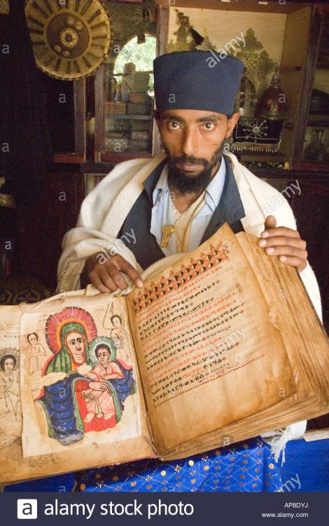 monk-with-an-ancient-bible-manuscript-in-a-monastery-museum-zege-peninsula-AP8DYJ.thumb.jpg.406cf81191cb1afb70de6b513db08455.jpg