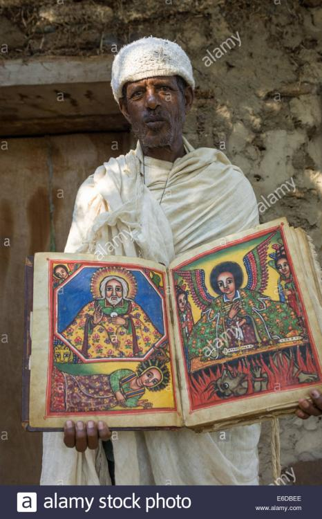 priest-holding-an-ancient-illustrated-bible-outside-of-the-church-E6DBEE.thumb.jpg.e003a793cb4323a0121038bbe2541572.jpg
