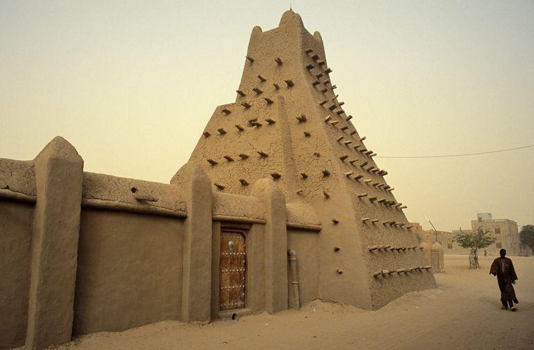 mali-timbuktu-or-tombouctou-a-man-strolls-past-the-town-s-15th-century-sankore-mosque-built-of-baked--doubled-as-a-university-140663281-57f799885f9b586c35320bdf.jpg.9ed6fbd47cd9bf83cd30bfbea72420fc.jpg