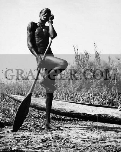 0131312-SUDAN-NUER-MAN-A-Nuer-man-standing-on-one-leg-in-the-manner-of-a-waterbird-as-he-rests-besid-wamp-near-Malakal-Sudan-Photographed-by-Eliot-Elisofon-1947.jpg.696bed2070fd8503f8e76c29b5e408b0.jpg