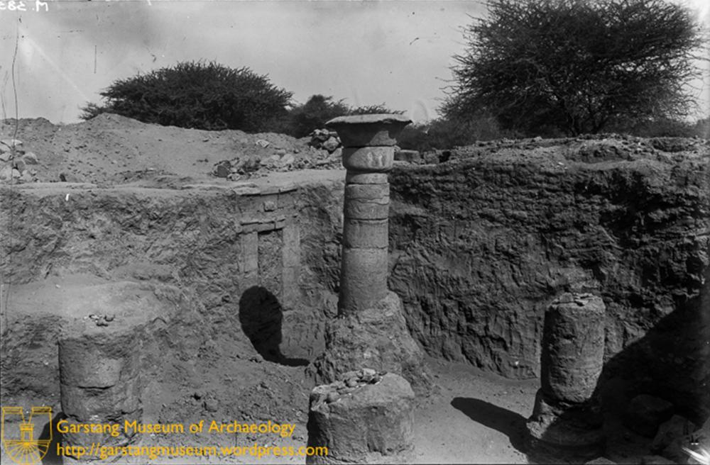 Kingdom of Kush Kushite In-tact column standing in situ at Meroë near to a decorated doorway in the wall of a trench.jpg